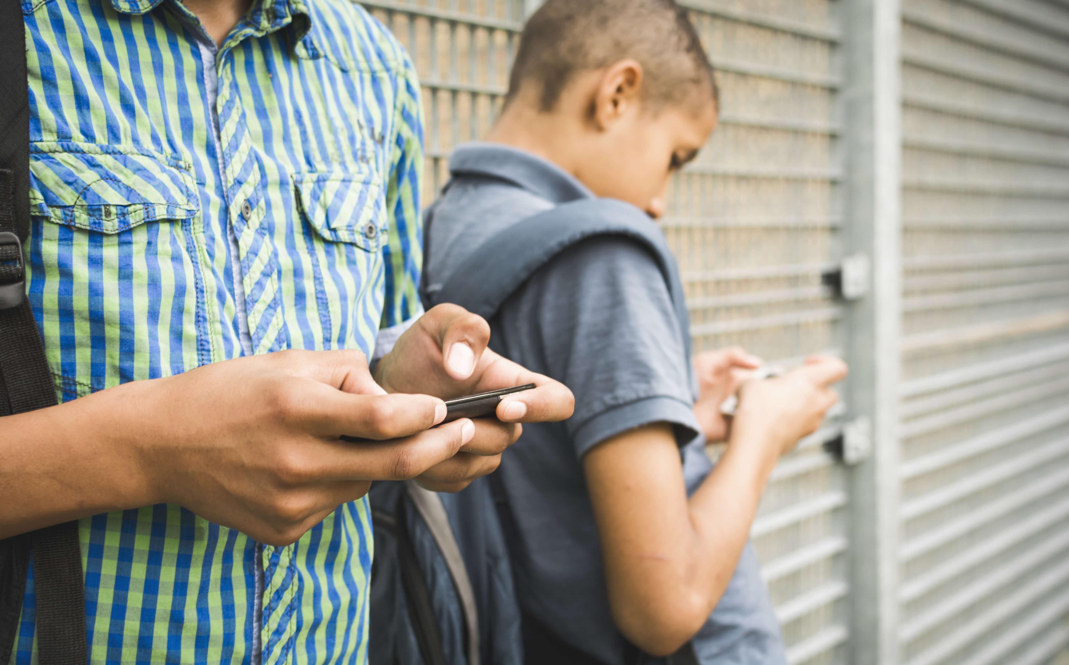 bigstock Kids texting message on smartp 72301885