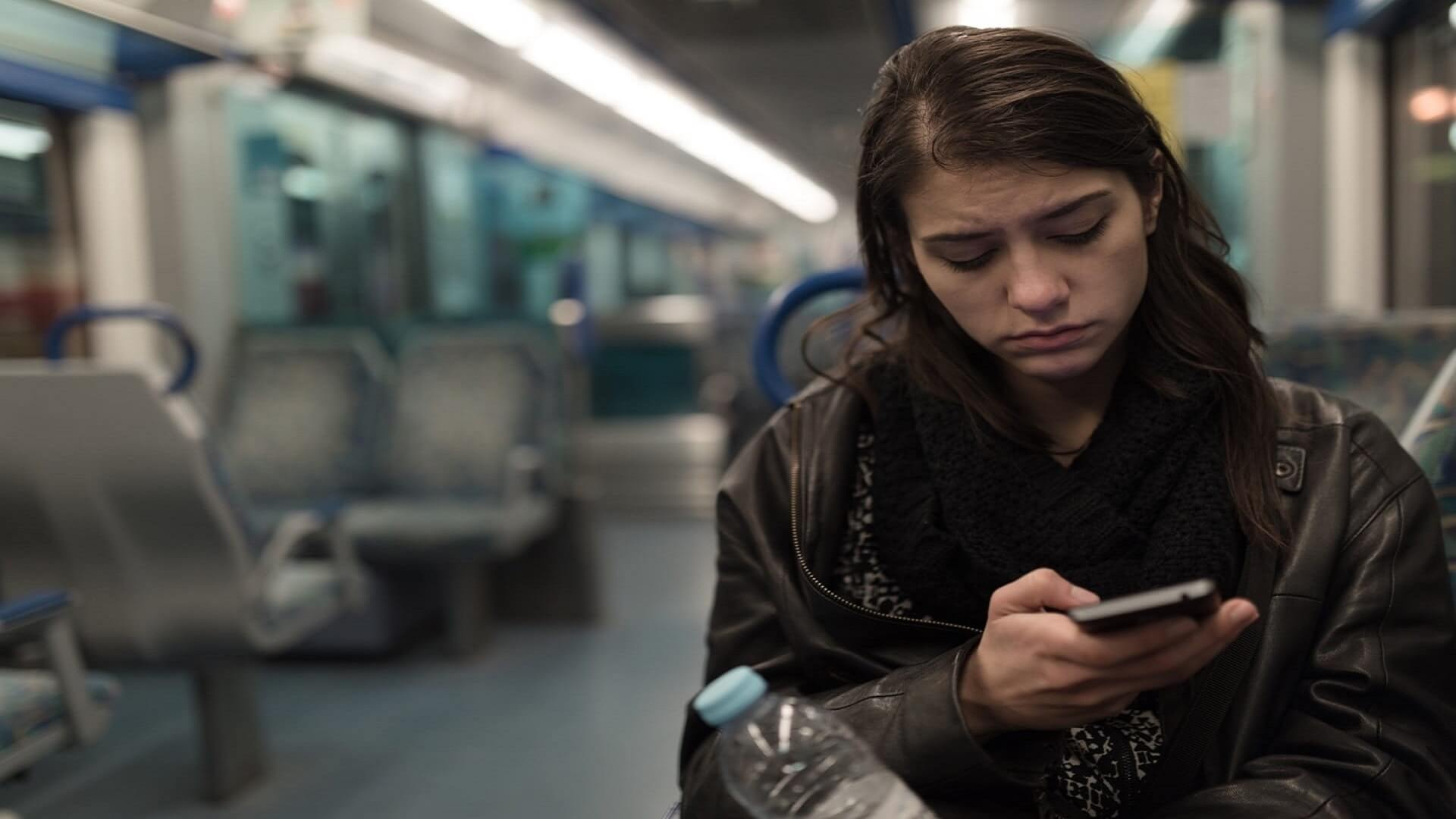 unhappy woman with pms on the train 1