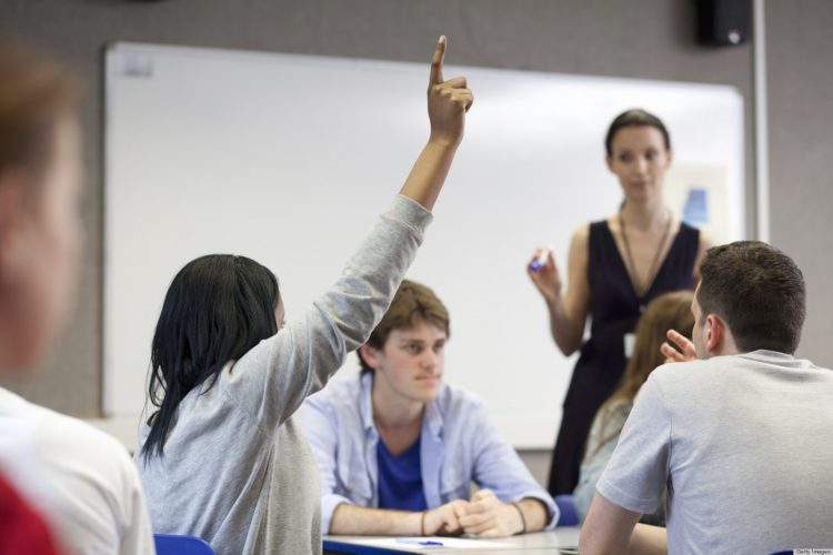 students in a classroom with a teacher / lecturer