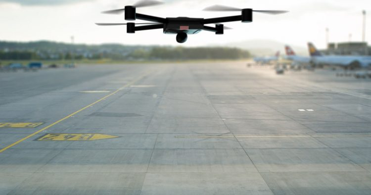 drone flying above the airport runway