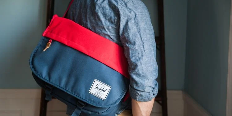 person-with-red-and-blue-bag