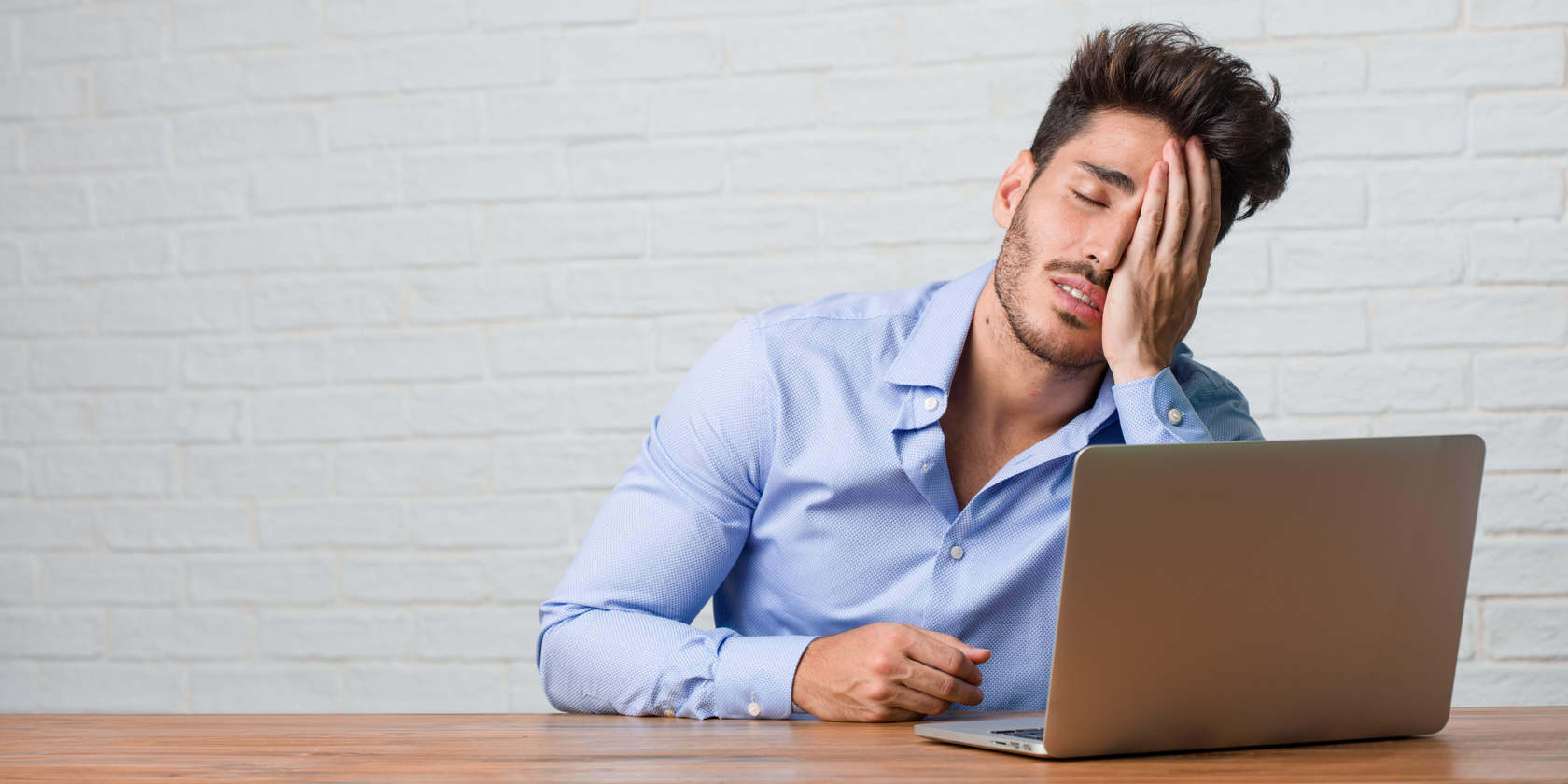 frustrated man sitting at computer feature 1