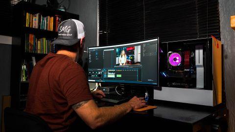 man editing video pc