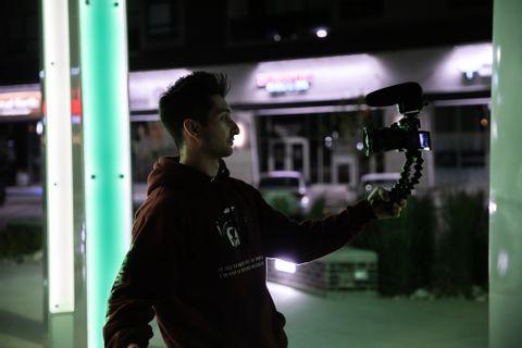 man recording himself with camera